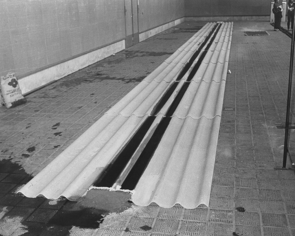 Abandoned Situation , 1971 放置状況 ( H  ōchi Jōkyō )  Corrugated slate sheets, cement, water, ink 10 x 200 x 2200 centimeters Installation view,  10th Contemporary Art Exhibition of Japan , Tokyo Metropolitan Art Museum, Tokyo, 1971. Photo: Shigeo Anzaï
