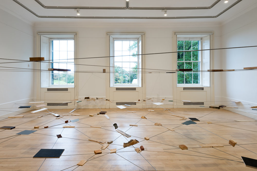 Left-Behind Situation , 1972/2016 捨置状況 ( Shachi Jōkyō ) Wood, stone, brick, zinc, bark, wire rope  Dimensions variable Installation view,  Karla Black and Kishio Suga; A New Order , Scottish National Gallery of Modern Art, Edinburgh, 2016  Photo: Sam Drake; Courtesy National Galleries of Scotland