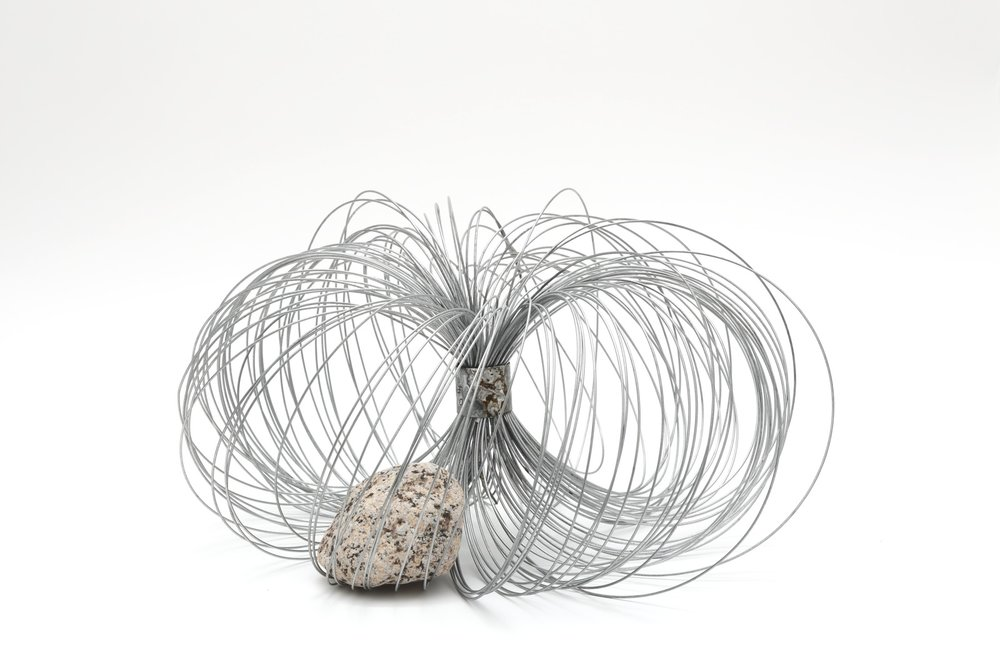 Qualities of Circulating Space , 2010 周界性 ( Shūkaisei ) Metal wire, rock 6 7/8 x 13 inches diameter  17.5 x 33 centimeters