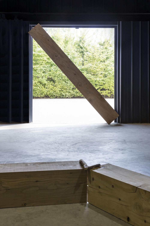Infinite Situation III (door) , 1970/2016 無限状況 III (扉)( M  ugen Jōkyō III [Tobira])  Wood, door, landscape Installation view  Kishio Suga: Situations , Pirelli HangarBicocca, Milan, 2016 Photo: Agostino Osio; Courtesy Pirelli HangarBicocca, Milan
