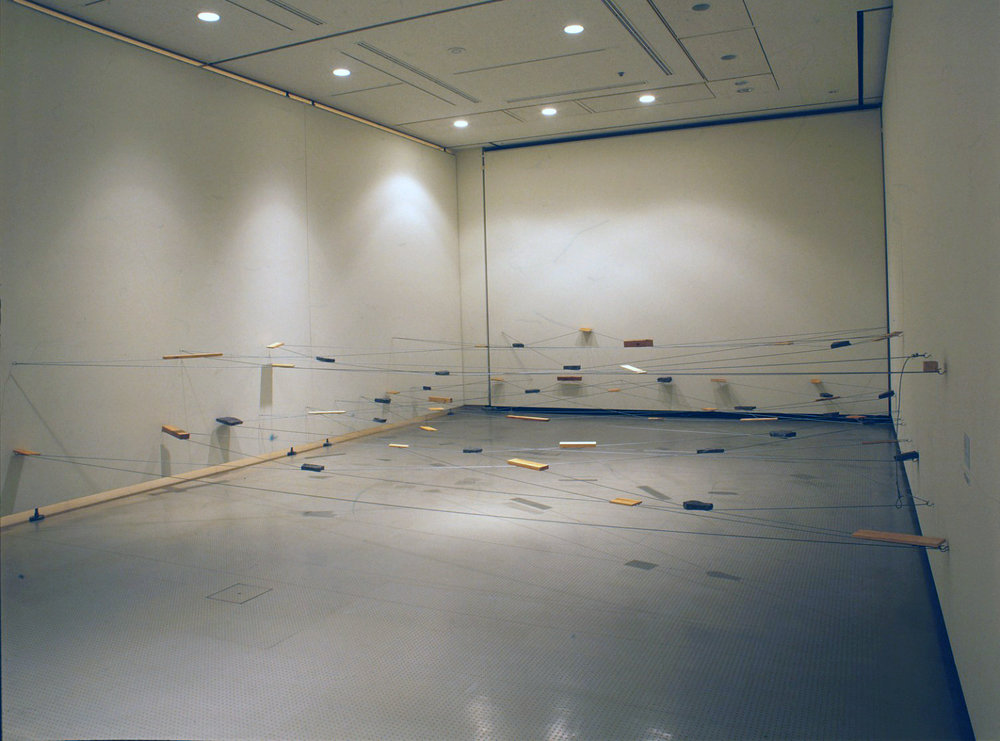 Left-Behind Situation , 1972/1995 捨置状況 ( Shachi Jōkyō ) Wood, stone, wire rope Dimensions variable Installation view,  Matter and Perception 1970: Mono-ha and the Search for Fundamentals , Hiroshima City Museum of Contemporary Art, 1995 Photo: Tsuyoshi Satoh