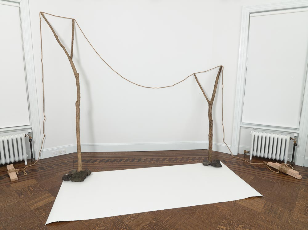 Continuous Existence—N , 1977/2015 連界—N ( Renkai—N ) Rope, branches, stones, paper Dimensions variable Installation view, Blum & Poe, New York, 2015 Courtesy Blum & Poe, Los Angeles / New York / Tokyo