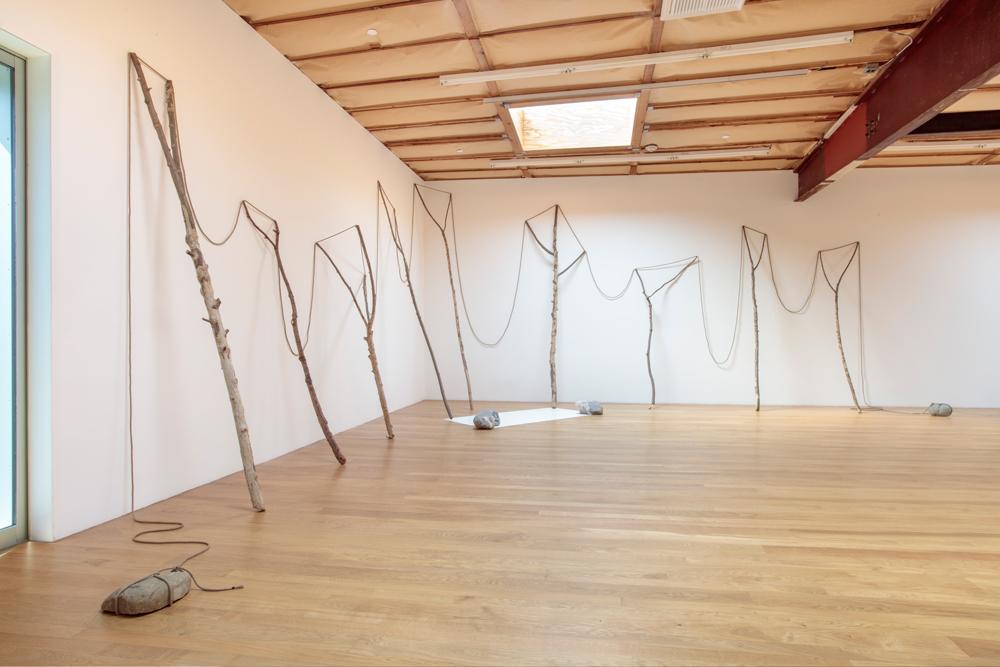 Continuous Existence—L , 1977/2017 連界—L ( Renkai—L ) Rope, branches, stones, painted zinc plate Dimensions variable Installation view, Blum & Poe, Los Angeles, 2017 Photo: Joshua White/JWPictures.com