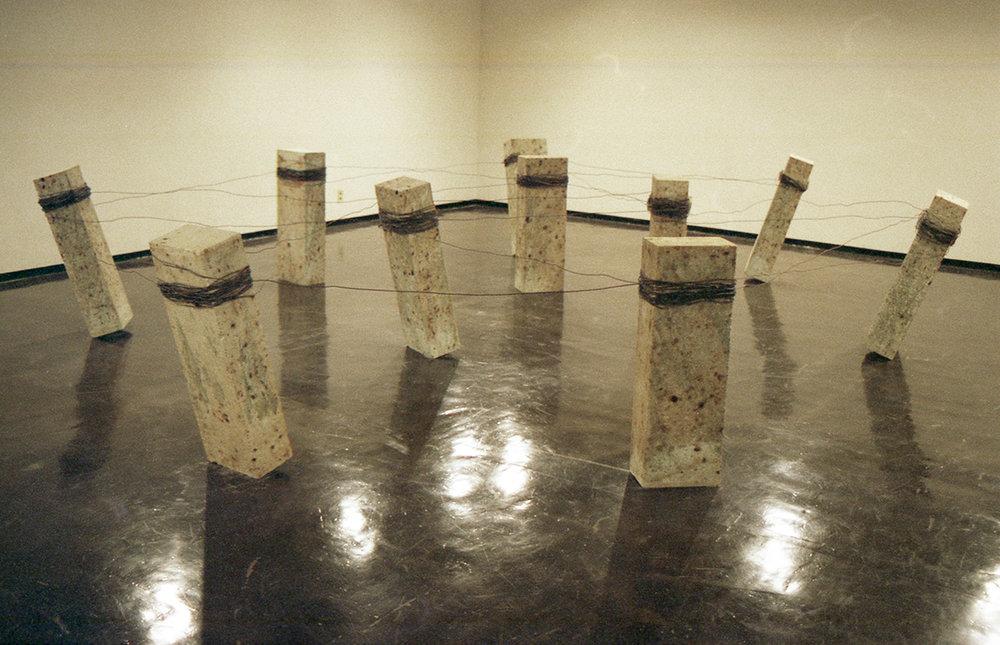 Placement of Condition , 1973/1998 状況置 ( Jōkyōchi ) Oya stone, wire Dimensions variable Installation view,  Kishio Suga , Kanagawa Prefectural Gallery, Yokohama, 1998 Courtesy Kanagawa Prefectural Gallery, Yokohama