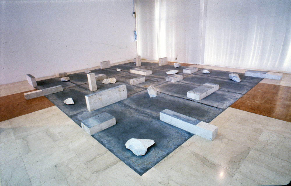 Gap of the Entrance to the Space , 1979/1992 界入差 ( Kainyūsa ) Zinc plates, stones Dimensions variable Installation view,  Avanguardie giapponesi degli anni 70 , Galleria Comunale d'Arte Moderna di Bologna, 1992 Photo: Tsuyoshi Satoh