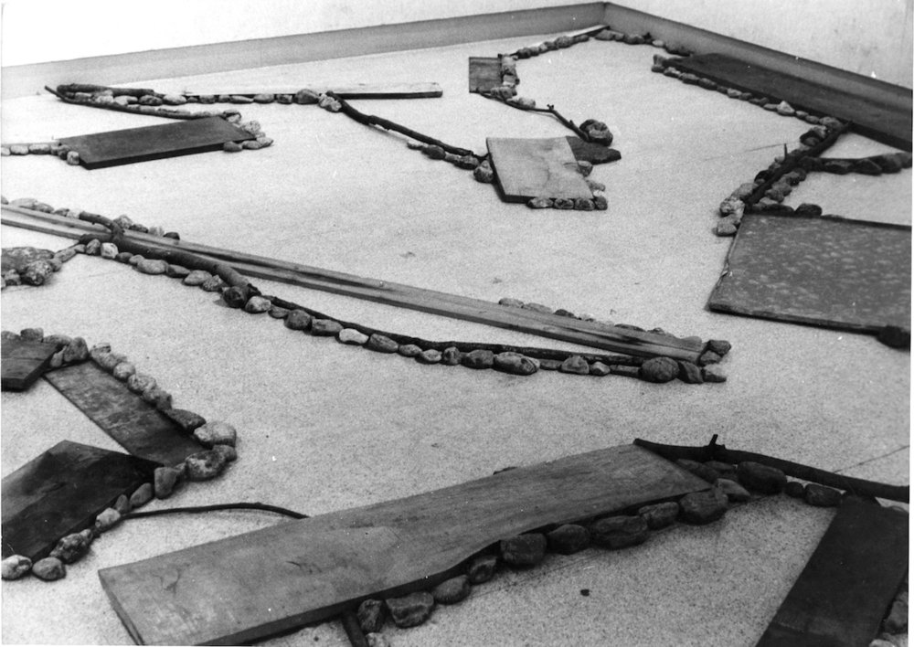 Matter and Location , 1980 事位 ( Ji'i ) Wood, branches, paper, zinc plate, stones Dimensions variable Installation view, Gallery Saiensu, Morioka, 1980 Courtesy of Gallery Saiensu, Morioka