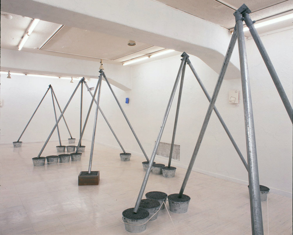 The Cultivation of Mother Earth , 2000 大地の育成 ( Daichi no Ikusei ) Steel pipes, buckets, wooden box, rope 310 x 935 x 228 cm Installation view, Tokyo Gallery, Tokyo, 2000 Courtesy Tokyo Gallery + BTAP