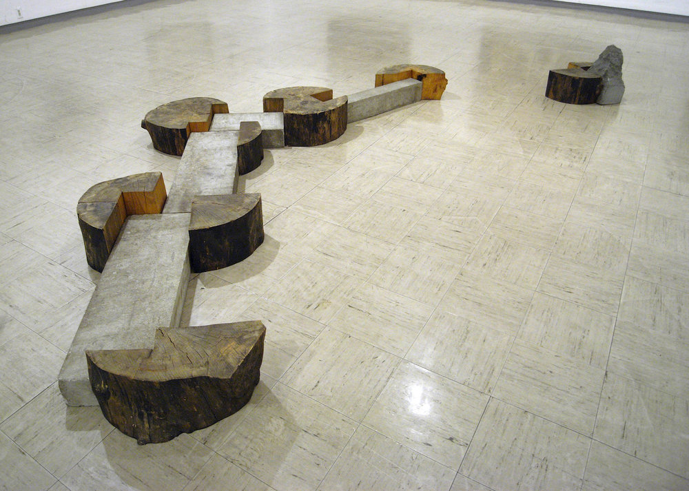 Kishio Suga,  Spreading Wood '86  (1986), wood, stones. 440 x 240.0 x 42.5 cm. Installation view at   Yokohama Civic Art Gallery, 1996. Photo: Tsuyoshi Satoh.
