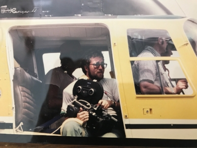 1978, Bangor, Maine- Henry prepares to shoot whitewater rafting from a helicopter.