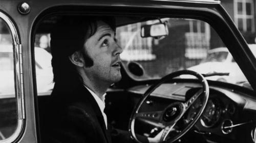 Paul McCartney leaving the Apple headquarters in London, 19th April 1969..jpg