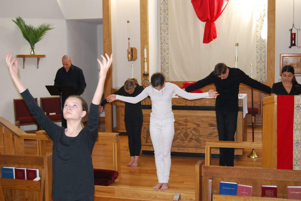 Our youth participating in worship through drama and dance.
