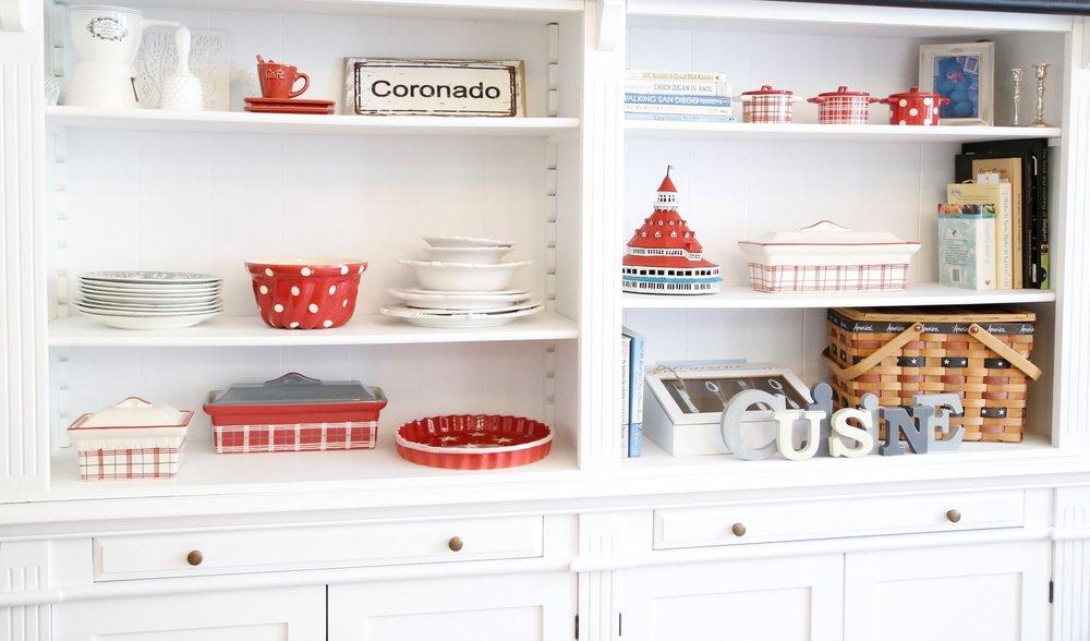 red ceramics on white shelf.jpg