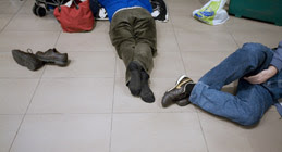 Sleeping traveller at Treviso airport