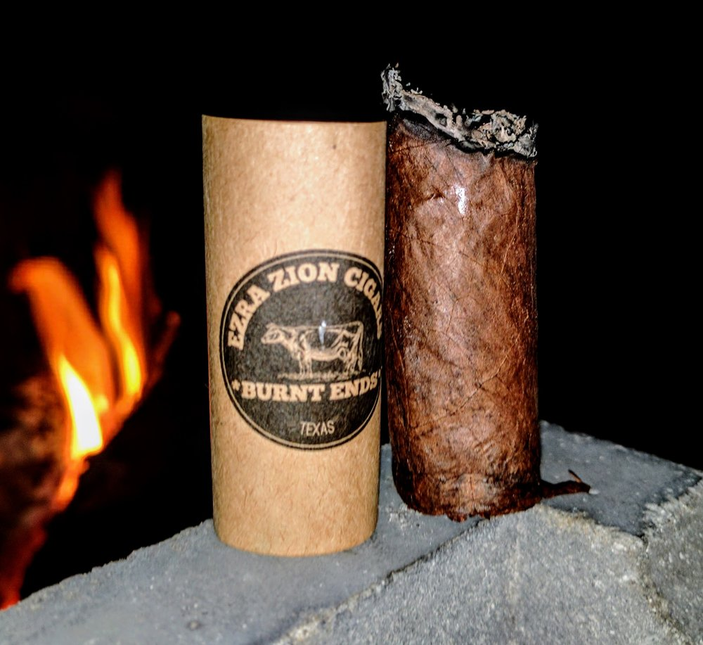 7.6 / 10 hard to argue with bbq.  - Burnt Ends is a gorgeous cigar to look at. While some of Ezra Zion's names tend to be misaligned to the actual flavor profile, I think Burnt Ends nailed it.The cigar is immensely flavorful - packing in some great smokey, barbecue, beefy notes with just enough pepper.  Where it not for the burn issues at the end, I'd happily have nubbed this stogie!  I'll be reaching for one again shortly to see if the last third is a repeat performance - at least I know the front two-thirds are money!  All in all, enjoyable - especially around a fire on the Fourth!