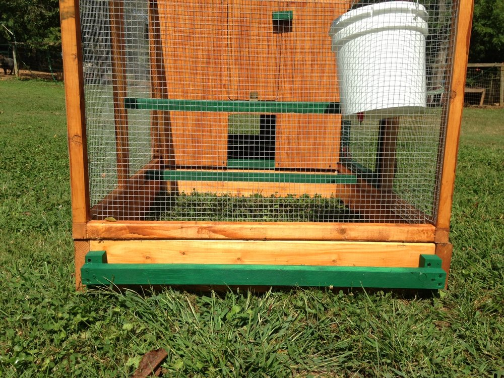 Front of stained coop with handle.jpg