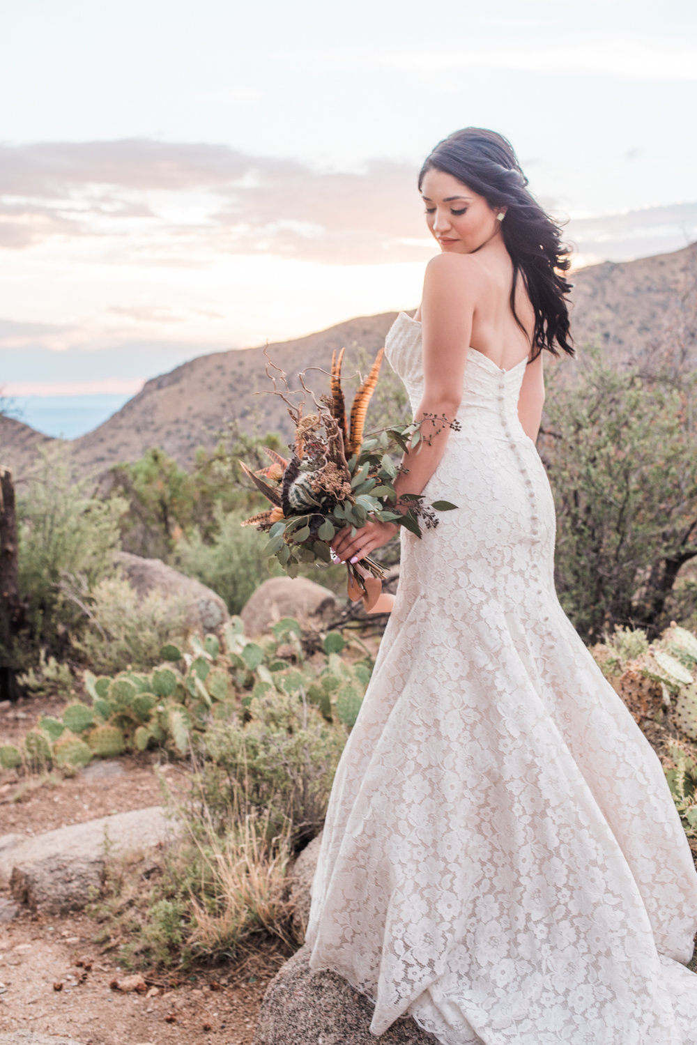 Published inprint & online - Albuquerque New Mexico Perfect Wedding Guide. Photographer: Briana Nicole Photography. Sandia Foothills, New Mexico.