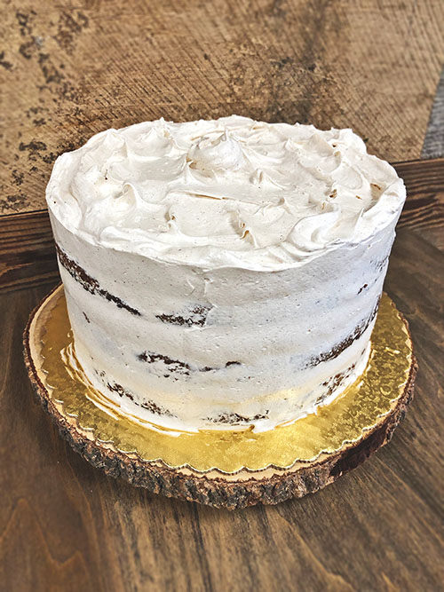 Our frosting style is simple and rustic, displaying all three layers of the cake.