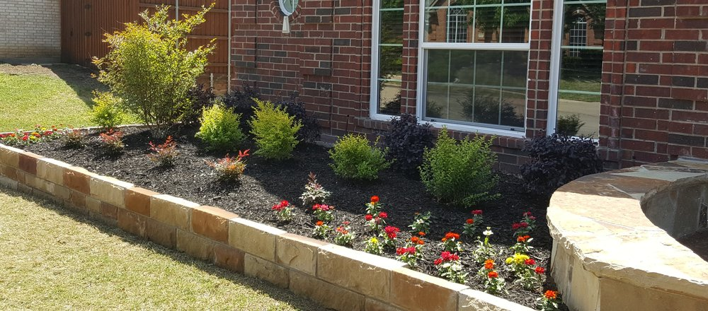 Residential Landscape - New bedding, shrubs, trees, seasonal color or complete redesign including stonework and planters for added visuals and updates - we do it all.