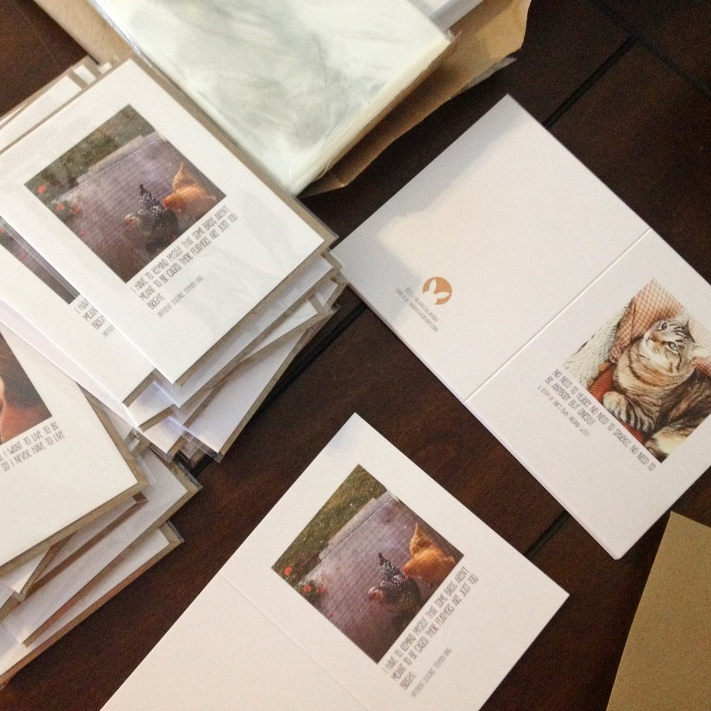 Getting cards ready for sale at an upcoming art market. Quality of printing and packaging is one of the things people look at when they handle your products.