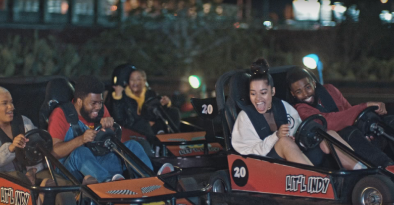 "Ella Mai (second-to-last, left to right) in the music video for ""Boo'd Up."" [Image Credits: Google Images]"