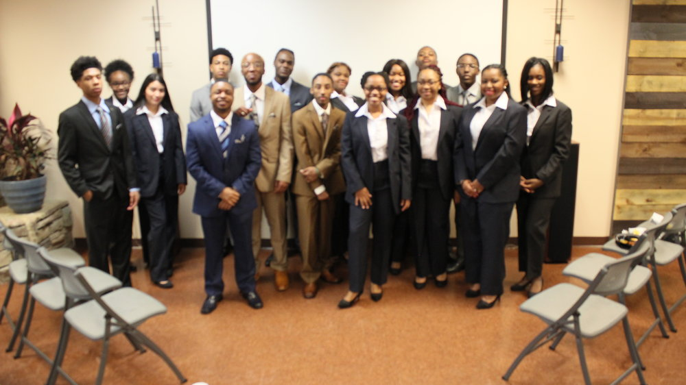 STS students model their new suits from New York Suit Exchange.