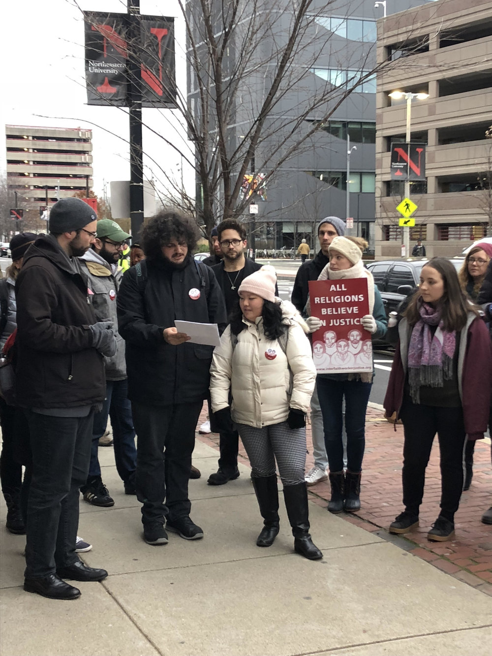 About 50 faculty, students, union members and community allies gathered at Northeastern to deliver the letter to President Aoun calling on him to respect the full-time non-tenure-track faculty's right to vote. See below for some pictures from the action.