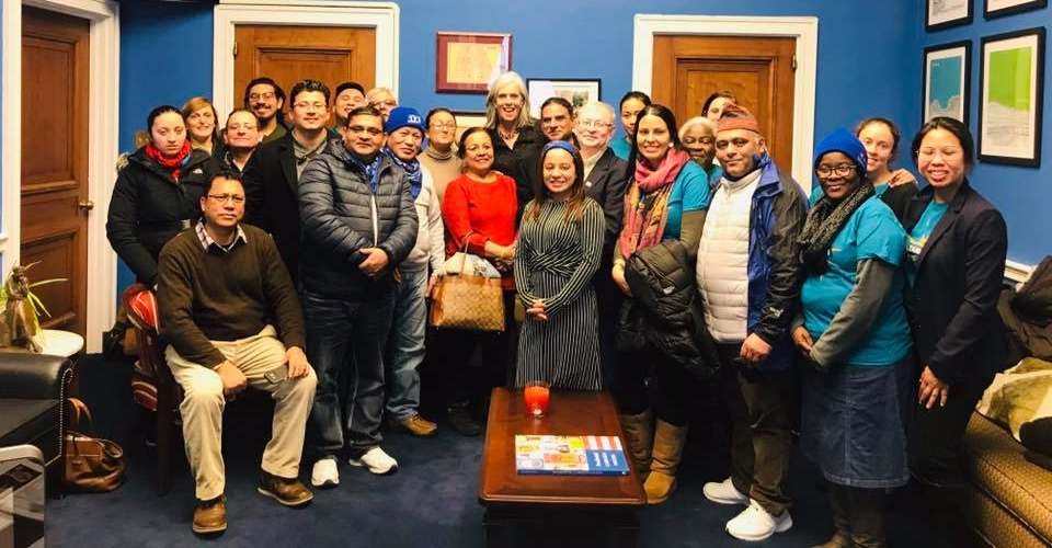 Nepalese TPS holders and allies meet with Katherine Clark, February 12, 2019. Sumi Hora center (blue head band/striped dress)