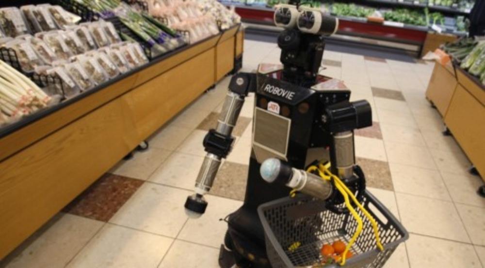 """Robot tên """"Robovie-II"""" do viện nghiên cứu robot Nhật Bản ATR phát triển đang đi mua sắm tại Kyoto năm 2010"""