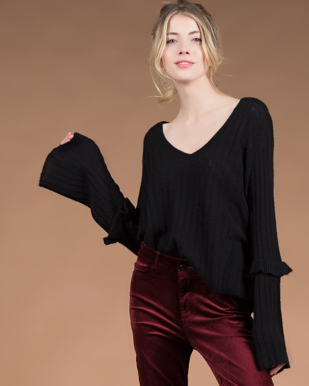 Baylee Ruffle V-neck - We're loving the bell-sleeved detail on this top. Dress it up with a velvet pant for a casual-cute friends-giving look.
