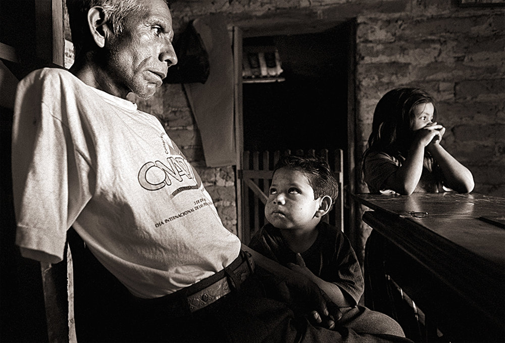 During the war, Pedro Bernal was a member of the Patruya Civil, civilian patrols forced into service by the Guatemalan army, when his town was overrun by guerillas. His arm was shot off as he fled an attack. Today, he lives in Nebaj with his two sons and grandchildren, David and Cristina.