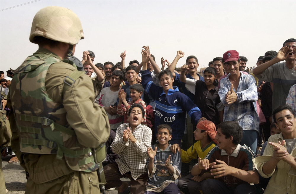 Despite severe casualties the day before, Marines from the Fox Company, Fifth Marine Division, were met with wild cheers as they entered Baghdad, Iraq, on April 10, 2003.