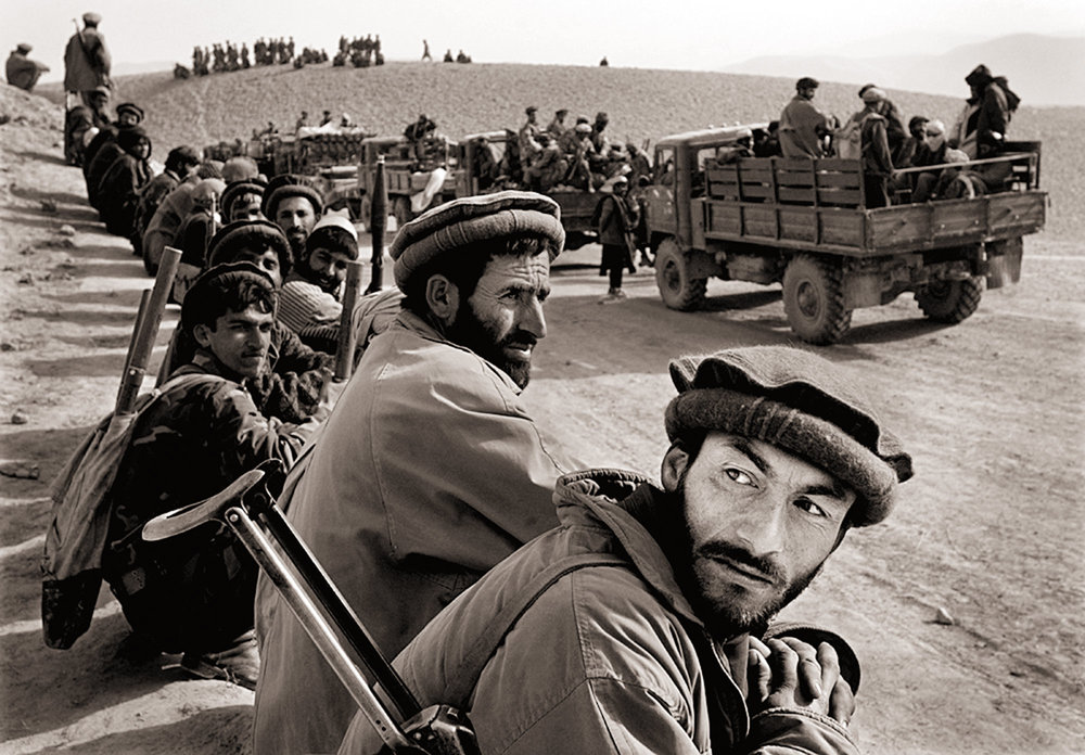 Northern Alliance soldiers watch anxiously as some 500 Taliban fighters surrender from Konduz. Mass surrenders kept casualties to a minimum during the takeover of the Taliban stronghold in northern Afghanistan.