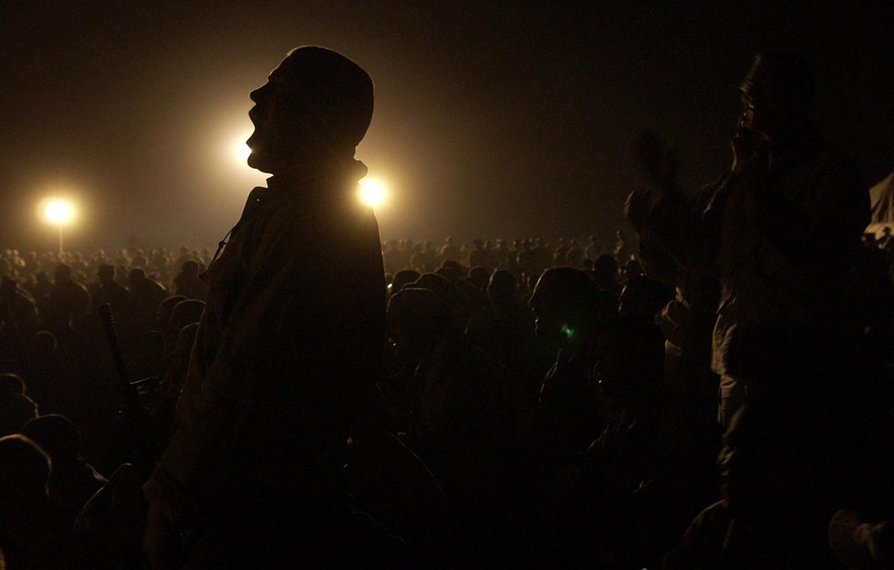 Lance Corporal Hunter Sorrells of Tennessee cheers fellow Marines during a talent show at Camp Coyote, the northern-most camp in Kuwait, as they wait for the U.S.-led strike against Iraq, March 14, 2003.