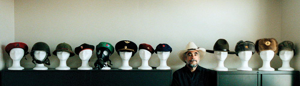 John Davidson, former Assistant Managing Editor of Visuals of The Dallas Morning News, is a Vietnam veteran who collects military hats gifted to him by his staff of photographers who travel the world covering the news.