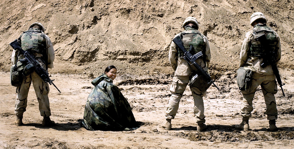 """The poncho never left my side throughout the war,"" said Cheryl Diaz Meyer, a photojournalist for The Dallas Morning News who posed for an honorary photo while she was embedded with the Second Tank Battalion's 1,000-man Marine unit during the Iraq invasion."