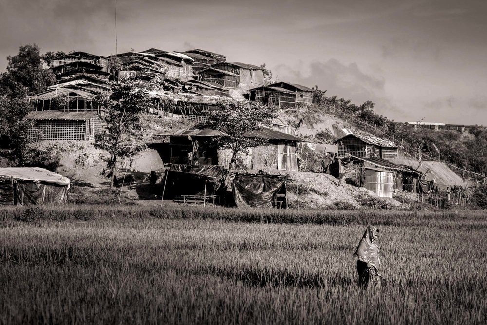 Once lush hills have been stripped of greenery as hundreds of thousands of Rohingya refugees who recently arrived in Bangladesh build shelters of plastic, tarpaulin and bamboo in Kutupalong Refugee Camp in Ukhia District, Oct. 11, 2017. As of September, the camp has over 10,000 shelters on 1.5 square miles, and is growing daily.