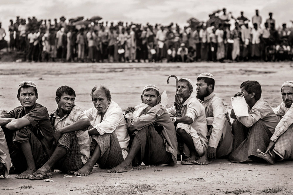 Hundreds of newly arrived Rohingya refugees wait for aid just outside the Noyapara refugee camp in Bangladesh on Oct. 6, 2017.