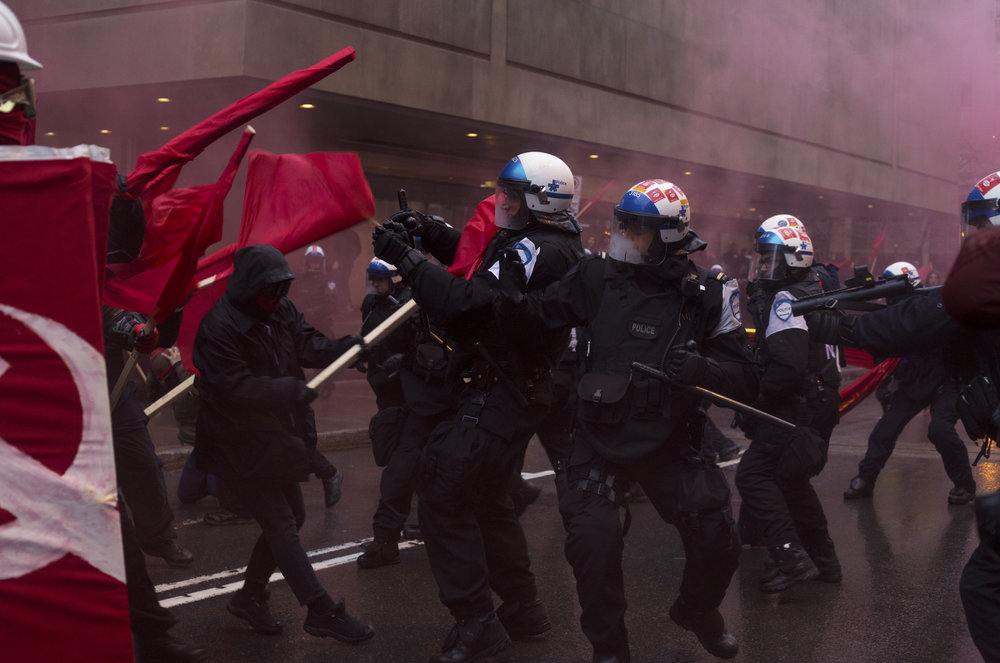 Protesters clash with riot police at an anticapitalist May Day demonstration in Montreal (May 1 2017)
