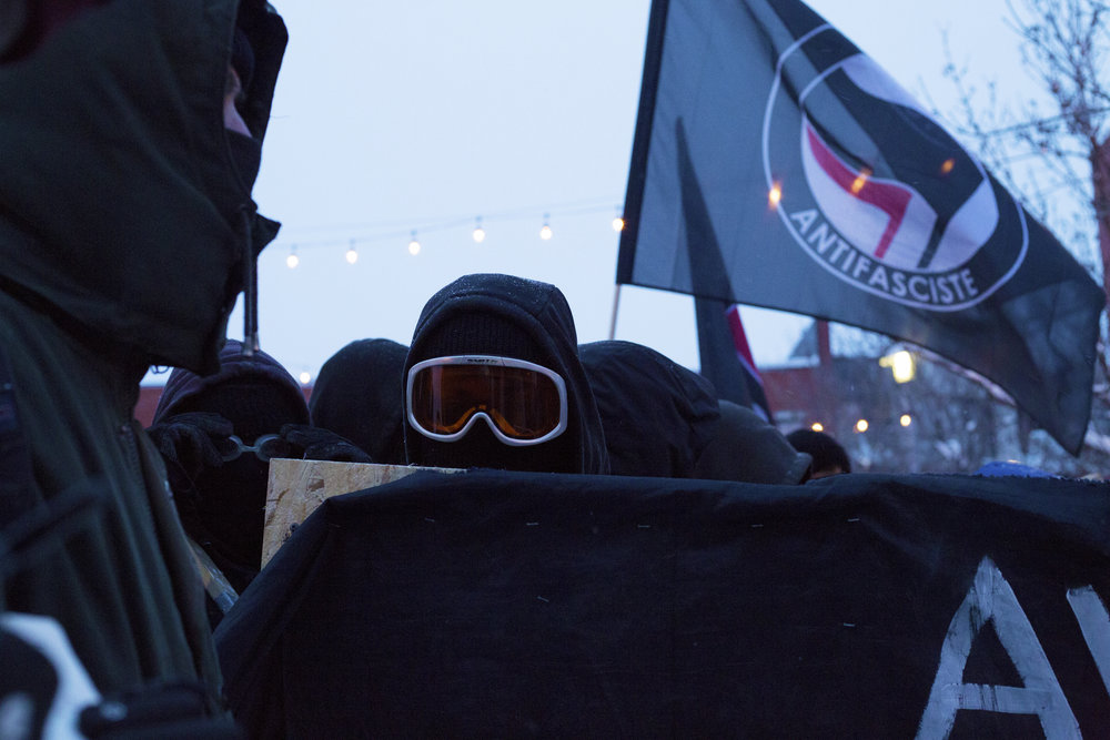 Masked protestors at a demonstration against police brutality in Montreal (March 15 2017)