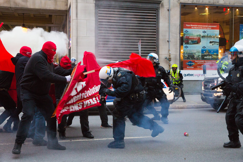 SPVM Riot police attacked by demonstrators during a May Day protest in downtown Montreal. (2018)