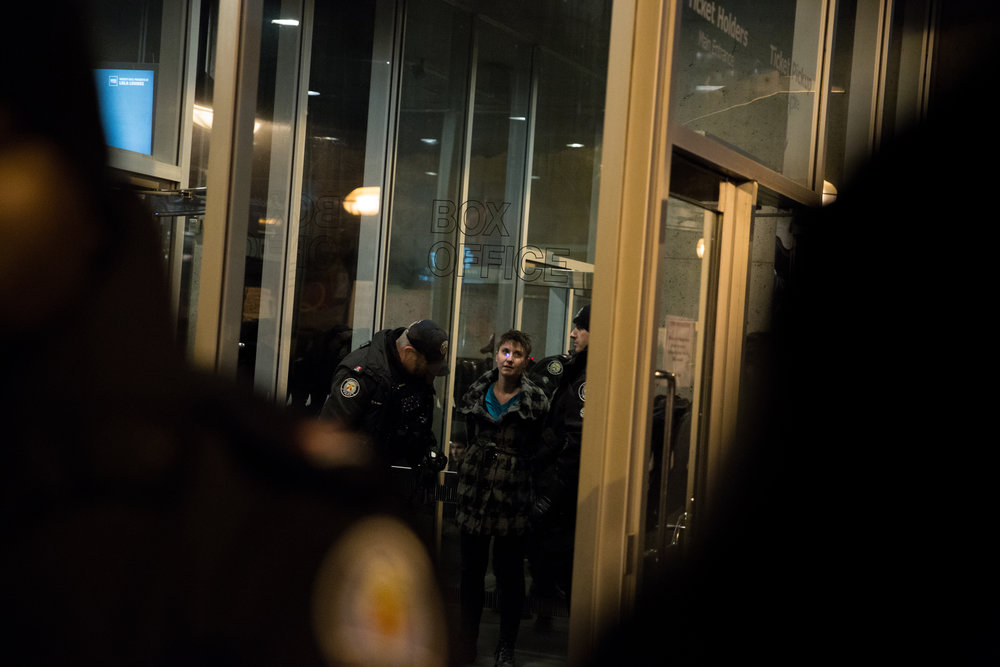 Demonstrator arrested by Toronto Police during a protest against a debate between David Frum and Steve Bannon [Nov 2 2018]