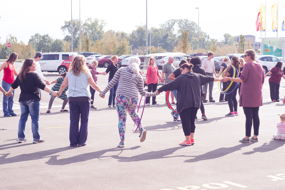 Playing a hula hoop game!