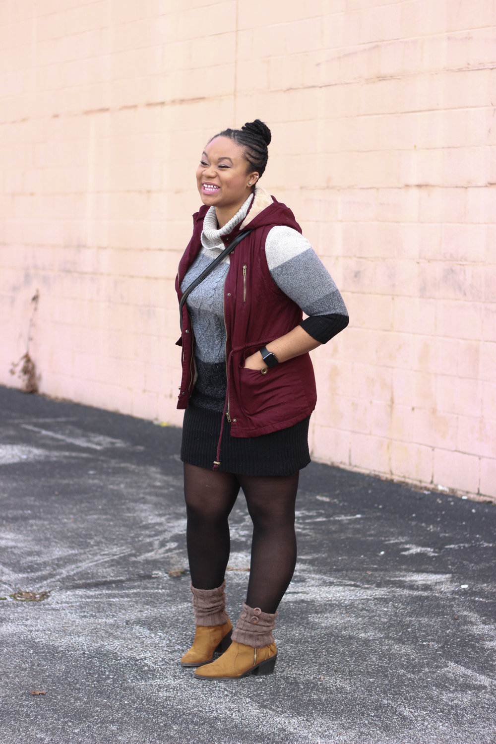 Pictured: Red Sweater Vest, Black Striped Sweater Dress, Brown Short Leg Warmers, Taupe Fringe Booties