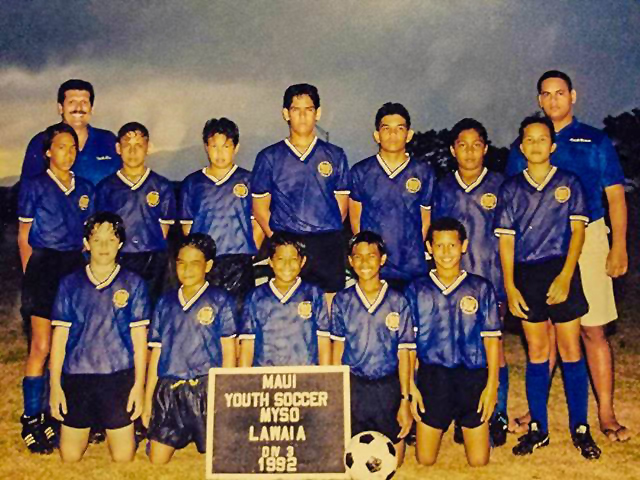 HSF President & CEO, Vernon Kapua'ala (in the back; far right), assisted Maui County politician, Michael Victorino in the Maui Youth Soccer league in the 90's