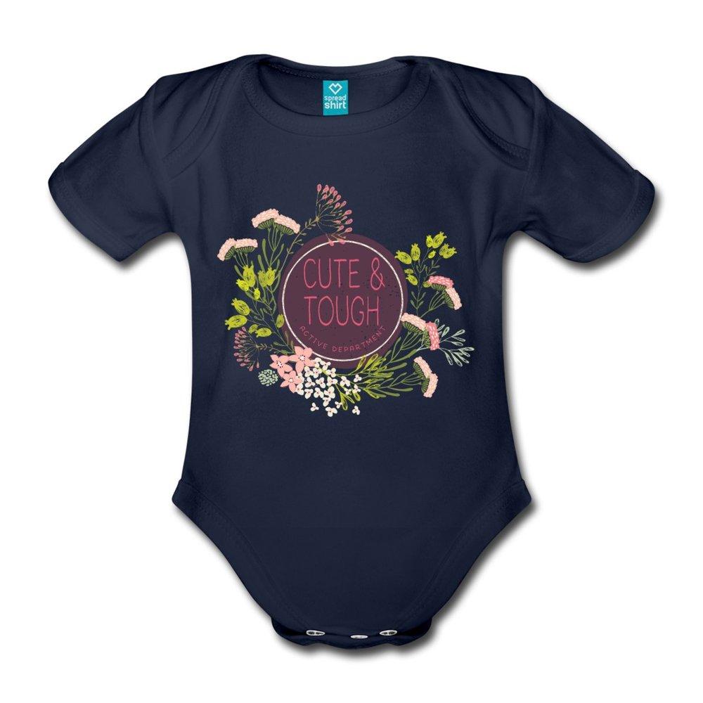 """Marinblå babybody i ekologisk bomull. Tryck """"Cute and tough"""" för alla busiga och tuffa barn."""