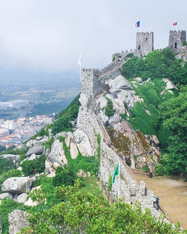 Want to hear something funny?⠀ ⠀ This picture of the Castle of the Moors might look like a clear, sunny day, but it wasn't. 😅⠀ ⠀ I was a little dumb and wore open-toed sandals, so climbing up and DOWN these ramparts was actually dreadful. I felt like I was going to slip and fall the entire time! BUT I loved the view so much.⠀ ⠀ Then I got lost on the way back to the bus. 🤷🏻‍♀️⠀ ⠀ url: https://ventureandeat.com/blog/sintra-lisbon-day-trip⠀ ⠀ #sintra #visitlisbon #visitportugal #liveunscripted #makemoments #openmyworld⠀ .⠀ .⠀ .⠀ #travelguide #femmetravel #sheadventures #discovertheworld #itchyfeet #travelisthenewclub #wearetravelgirls #placestogo #travellover #travelingtheworld #wanderlusting #travelgirl #sidewalkerdaily #ilovetravel #vacationlife #travelers #adventurethatislife #adventureculture #adventurevisuals #stayandwander #roundtheworld #travellog #vscotravel⠀ ⠀