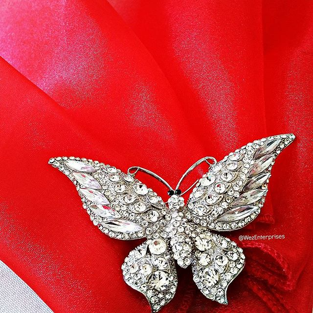 Our gorgeous butterfly just pops on our beautiful #Red organza. . Doesn't it just sparkle?