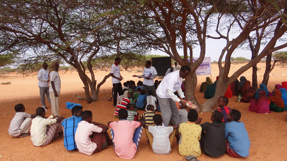 Somalis who have benefited from free tuition at the Iftiin school in Adado teach nomads in the literacy campaign