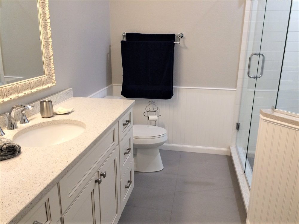 Elongated 1.28 GPF comfort height toilet. Ceramic undermount oval sink.