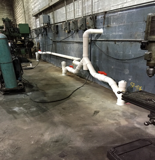 Commercial and residential vapor intrusion mitigation - Three point sub-slab depressurization system to control methane gas from the contaminated subsurface source. Installed with VaporTrac remote monitoring system.